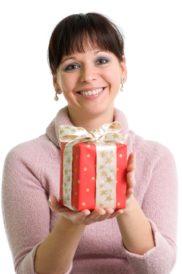 Young brunette with red Christmas present. Young brunette holding red Christmas present isolated over white royalty free stock image