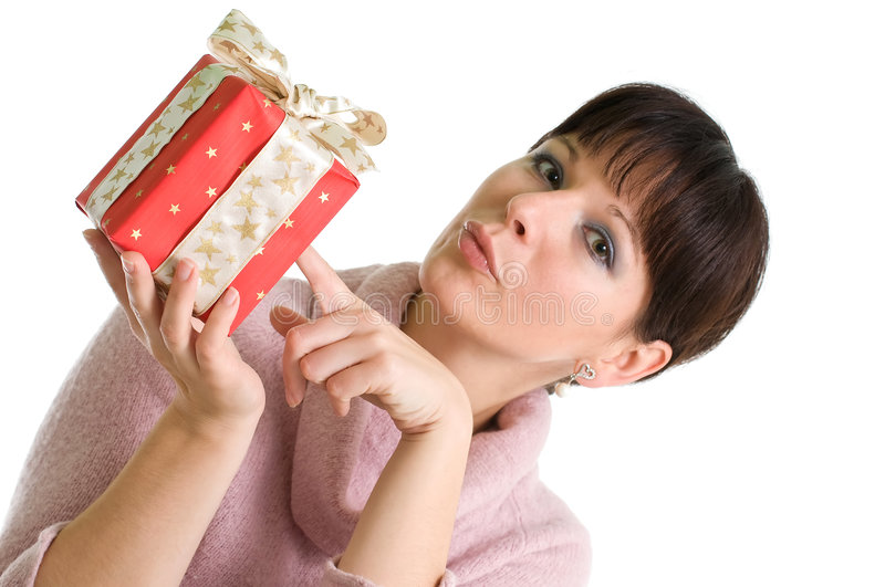 Young brunette with red Christmas present. Young brunette presents red Christmas gift isolated over white stock photos