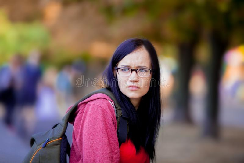 Young brunette student girl with backpack stock photo