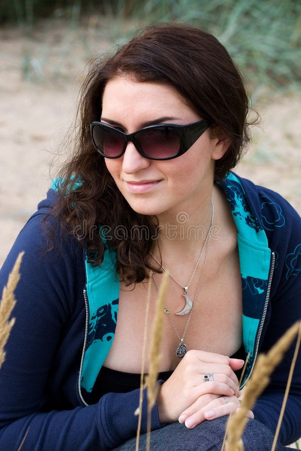 Young brunette in sunglasses