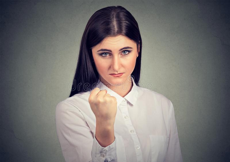 Angry woman threatening with fist stock photo