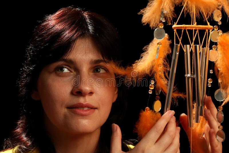 Download Young Brunette And Wind Chime Stock Photo - Image of metal, musical: 8880358