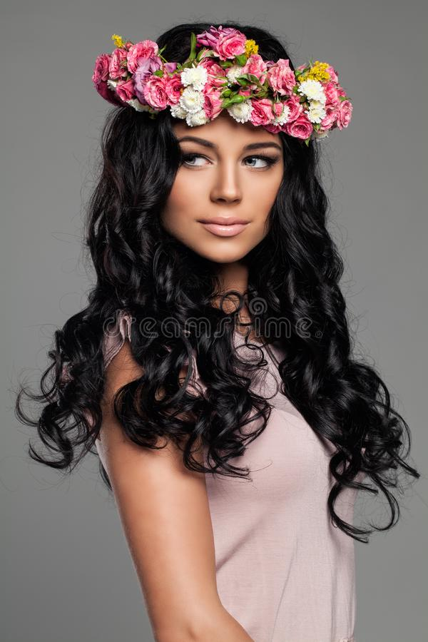 Young Brunette Woman with Curly Hair royalty free stock images