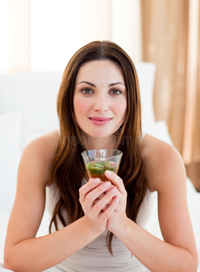 Download Young Brunette Woman Drinking Tea Sitting On Bed Stock Image - Image of positive, beautiful: 13155621