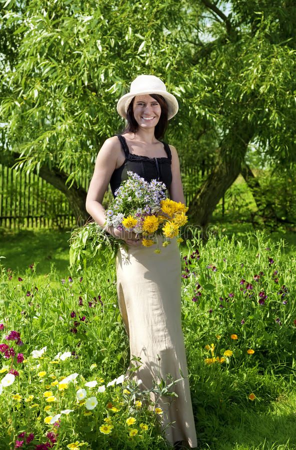 Young brunette woman with flowers stock images