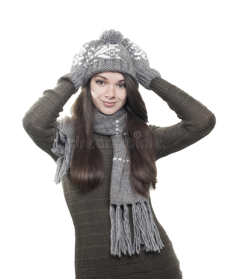 Young brunette woman in hat, gloves and scarf on white royalty free stock image