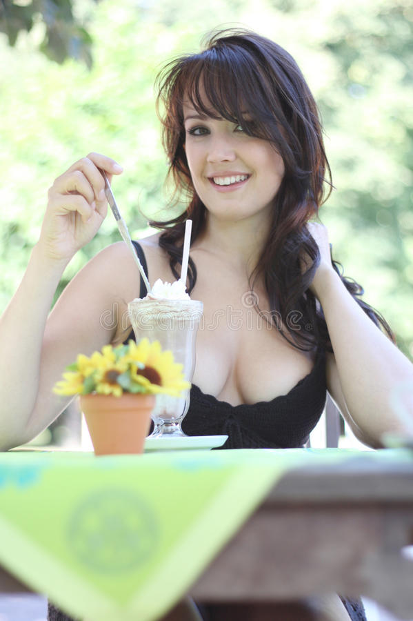Young brunette woman with ice cream stock images