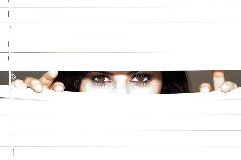 Download Young Brunette Woman Looking Through The Blinds Stock Photo - Image: 12355798