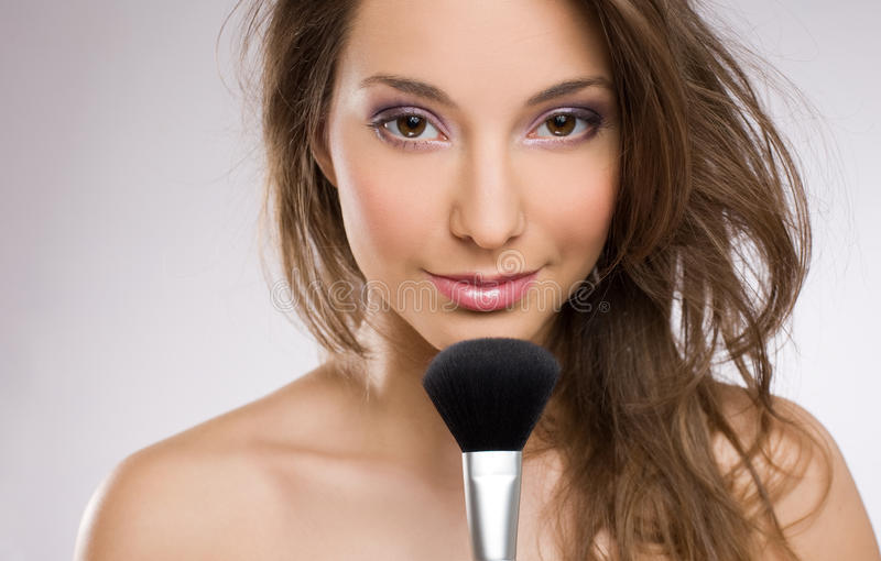 Download Young Brunette Woman With Makeup Brush. Stock Photo - Image: 23445944
