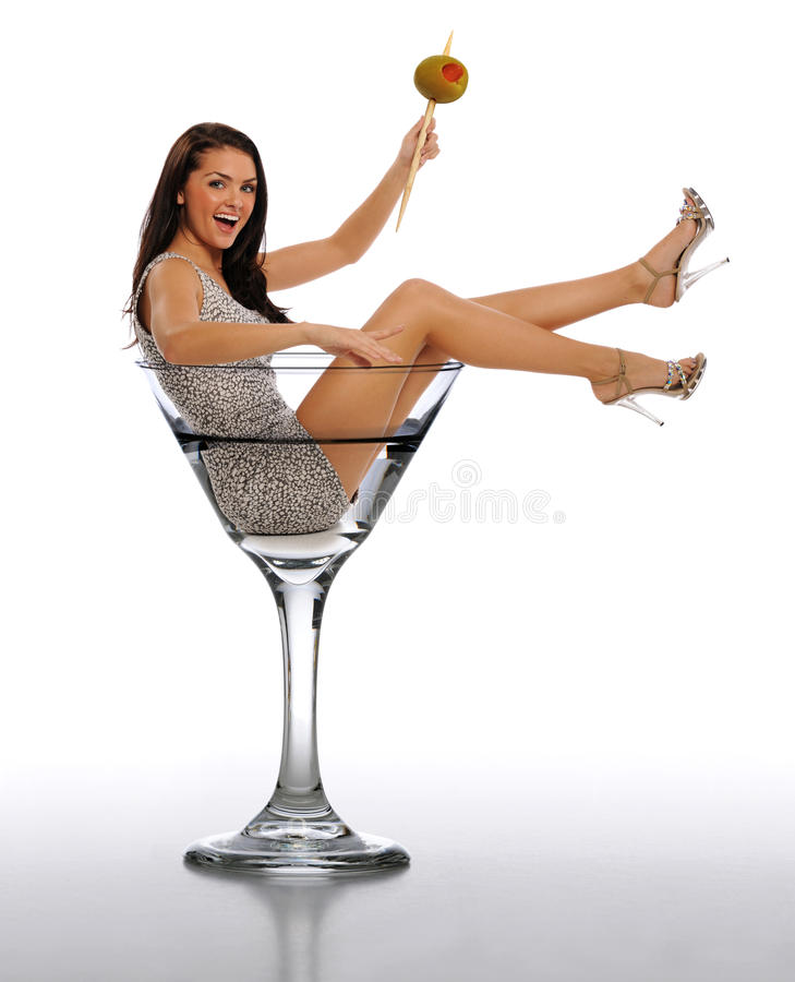 Young Brunette Woman in a Martini Glass. Isolated on a white background stock photo