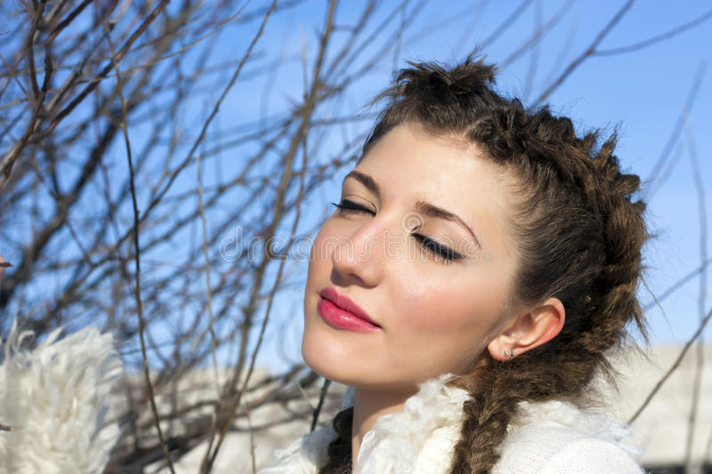 Young brunette woman portrait at sunny winter