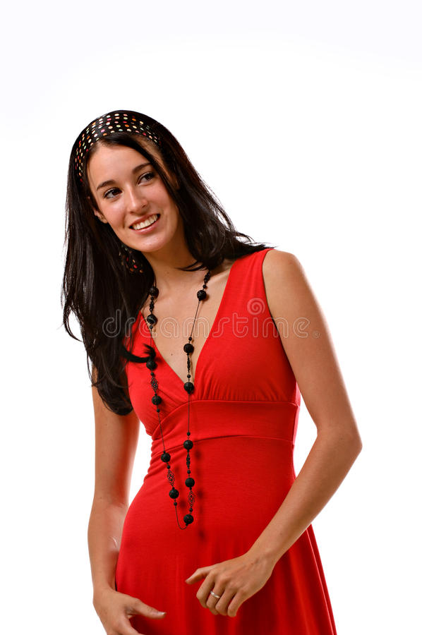 Young brunette woman in a red dress royalty free stock images
