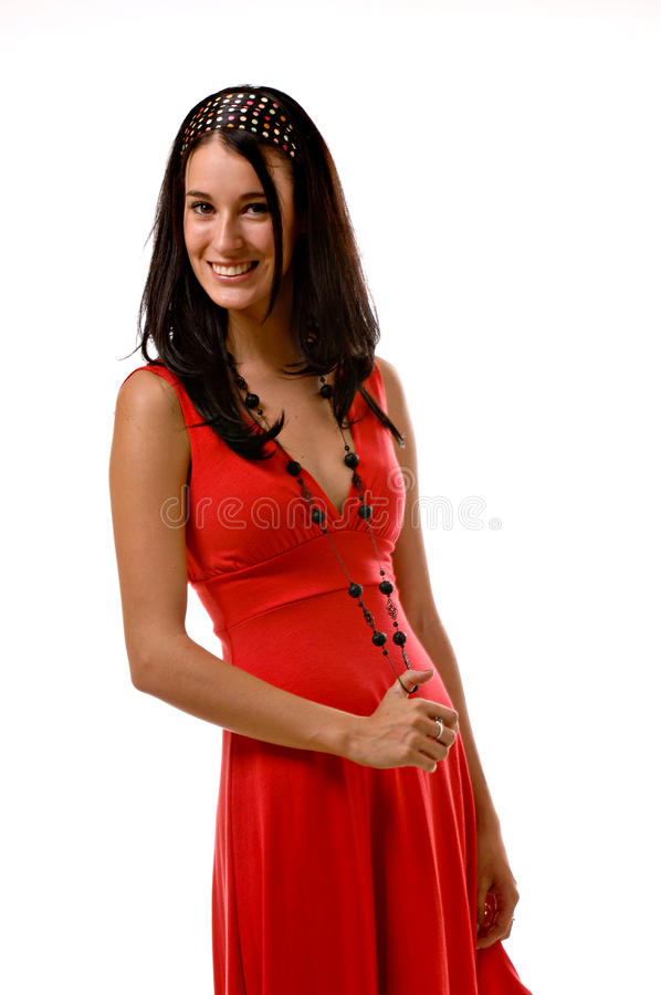 Young brunette woman in a red dress stock image