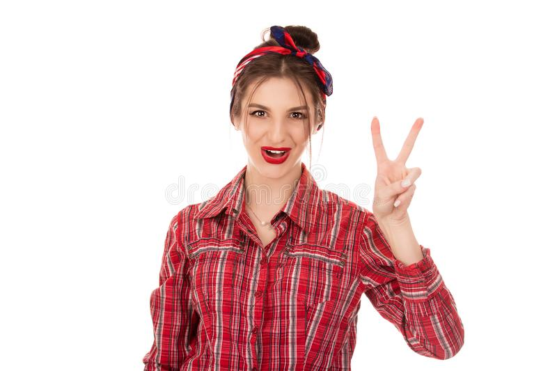 Woman showing and pointing up with fingers number two. Young brunette woman showing and pointing up with fingers number two while smiling confident and happy royalty free stock image