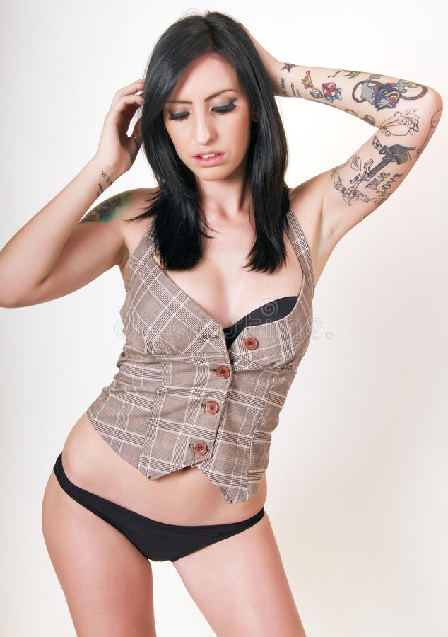 Young brunette woman with tattoos royalty free stock image