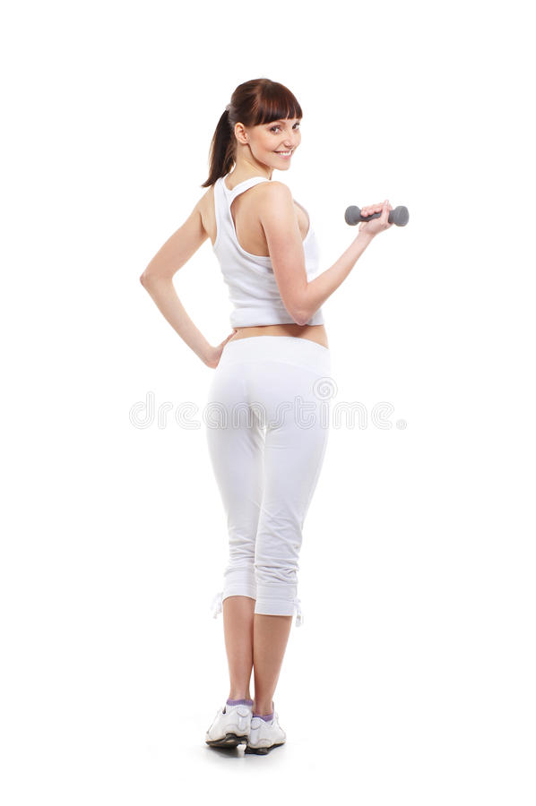 Download A Young Brunette Woman Training With A Dumbbell Stock Photo - Image of health, dieting: 19542268