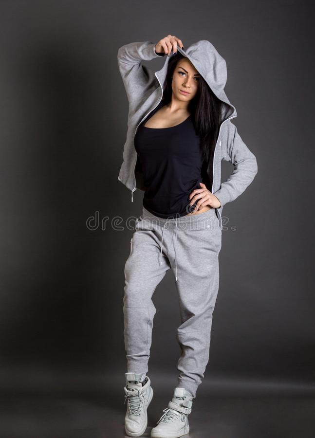 Young brunette woman wearing sportswear posing royalty free stock images