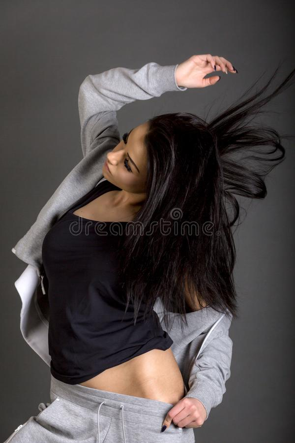 Young brunette woman wearing sportswear posing royalty free stock photos