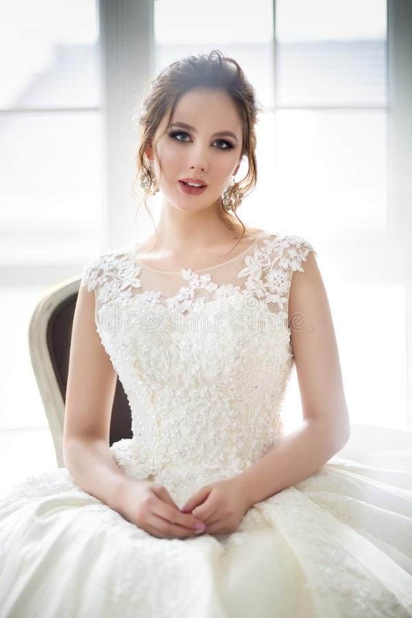 Young brunette woman in a wedding dress stock images