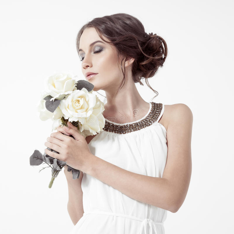 Download Young Brunette Woman And White Roses. White Background. Stock Image - Image: 34854977