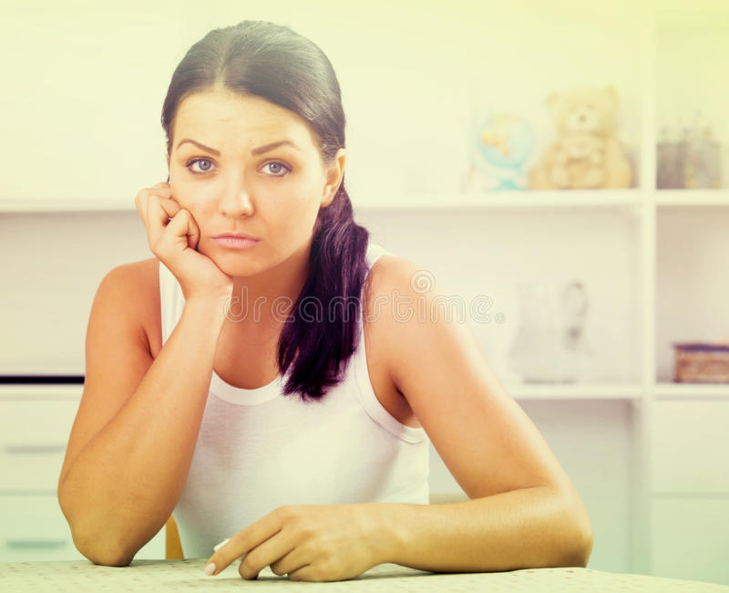 Young brunette woman wipes tears royalty free stock photo