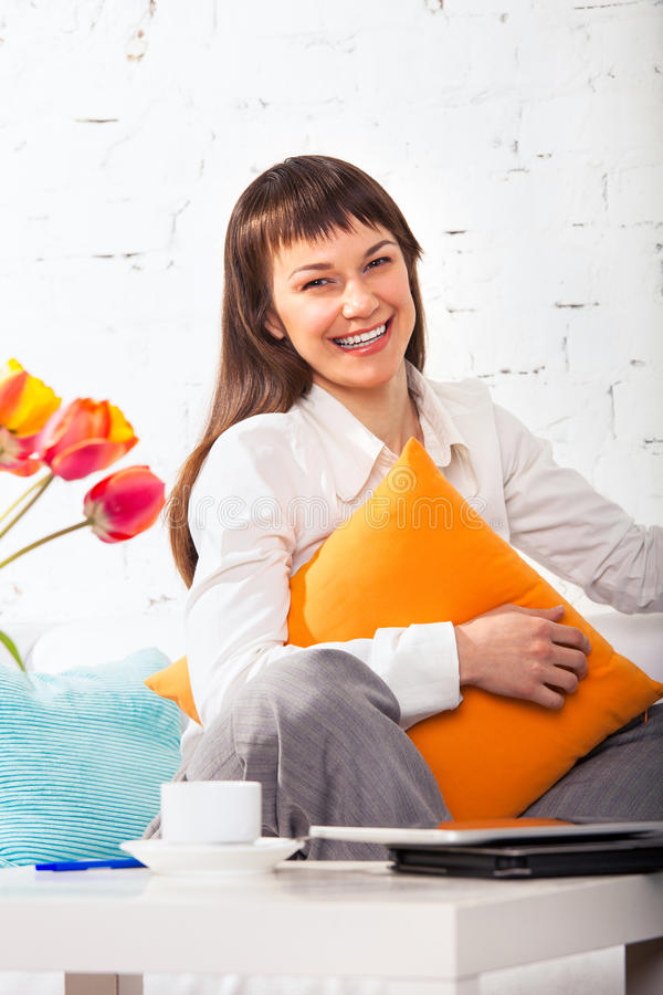 Download Young Brunette Woman Working At Home Stock Photo - Image: 27054796