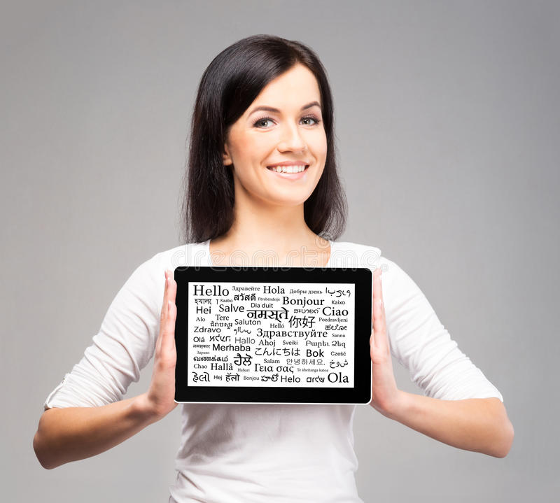 Free Young Bruntte Woman Holding A Tablet Royalty Free Stock Images - 70729339