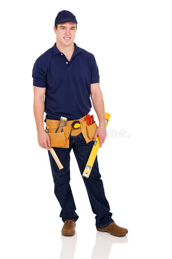 young builder holding level royalty free stock photo