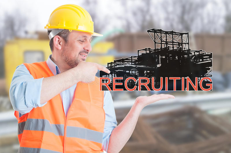 Young builder promoting engineering recruitment royalty free stock photos