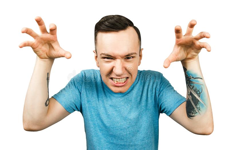 Young bully guy scares someone with his hands on a isolated white background stock photos