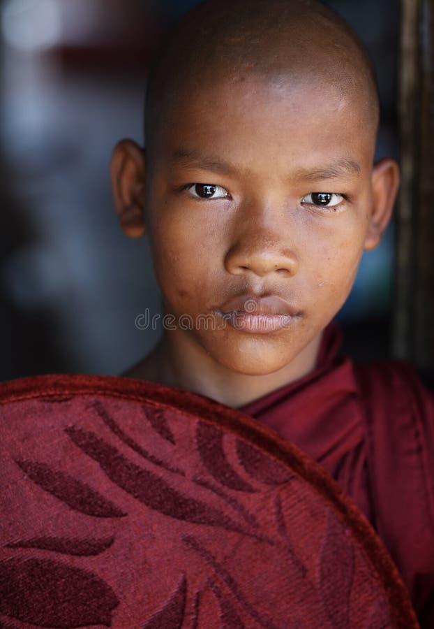 Young Burmese Buddhist novice in Mandalay, Myanmar. Young Burmese Buddhist novice in a monastic school in Mandalay, Myanmar stock photography