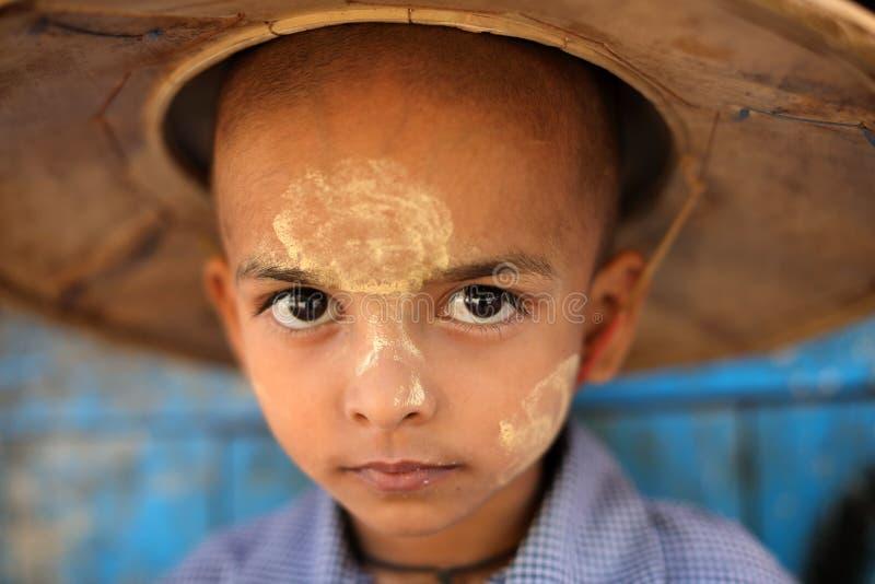 Young Burmese student in Mandalay, Myanmar. Young Burmese student with traditional hat in a monastic school in Mandalay, Myanmar stock photo