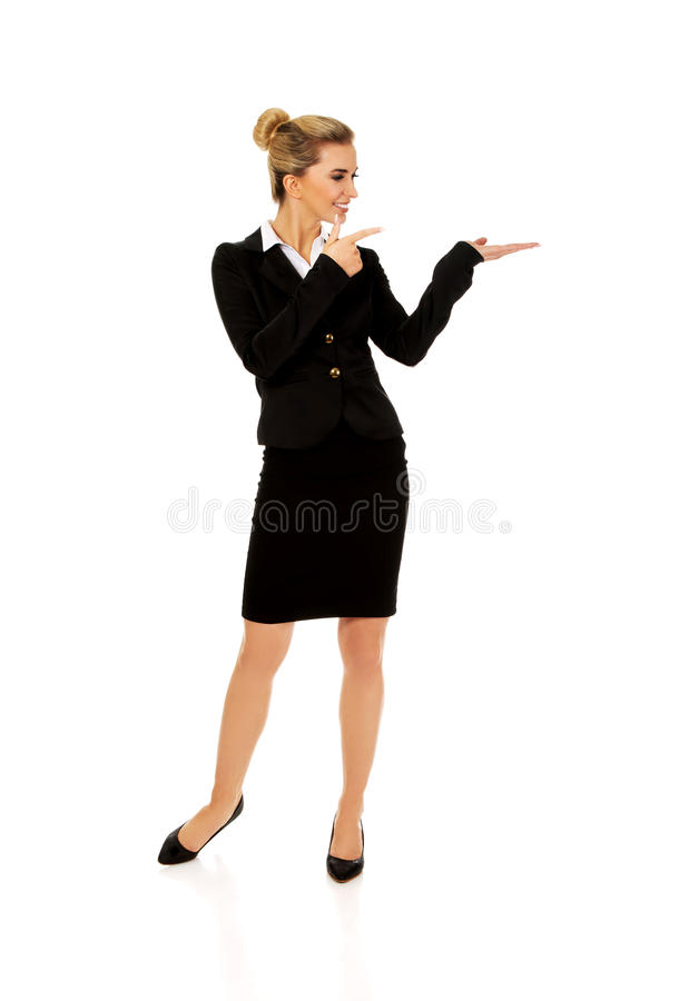 Young busiensswoman showing something. On hand royalty free stock image