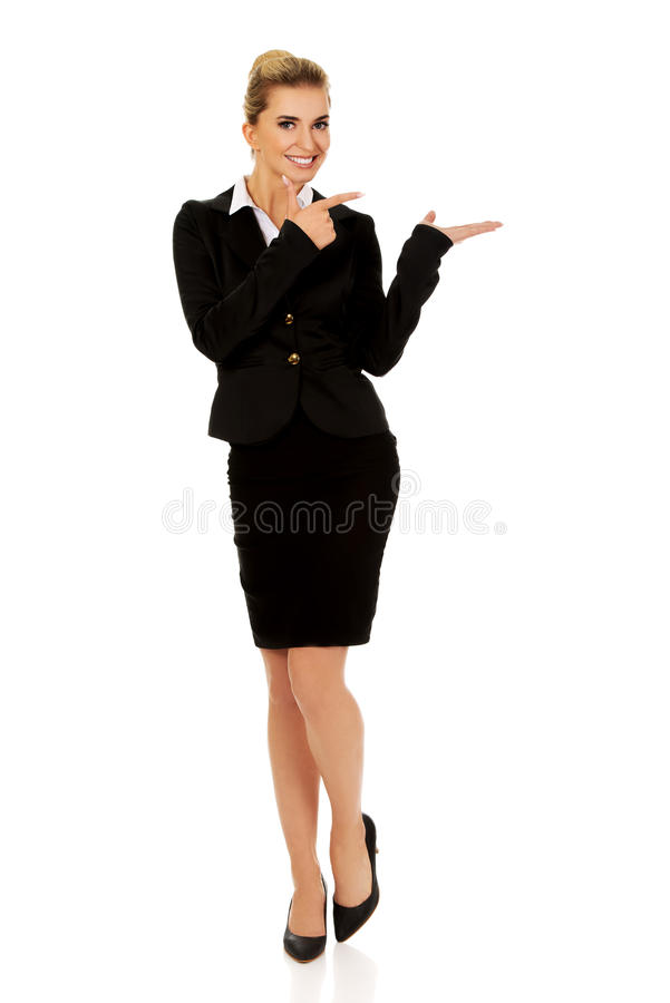 Young busiensswoman showing something. On hand royalty free stock photography
