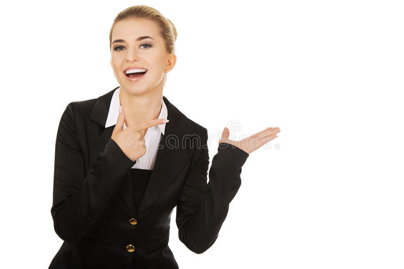 Young busiensswoman showing something. On hand stock photos