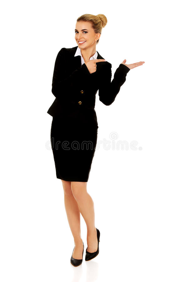 Young busiensswoman showing something. On hand stock image