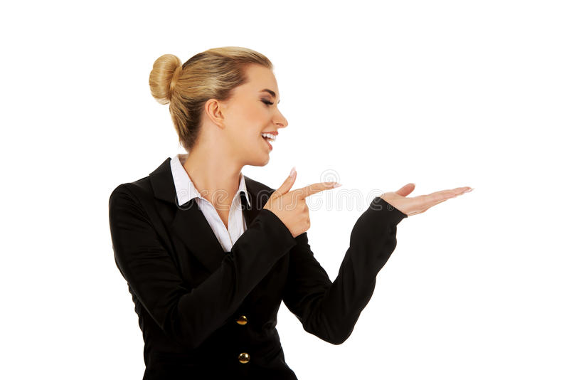 Young busiensswoman showing something. On hand stock photo