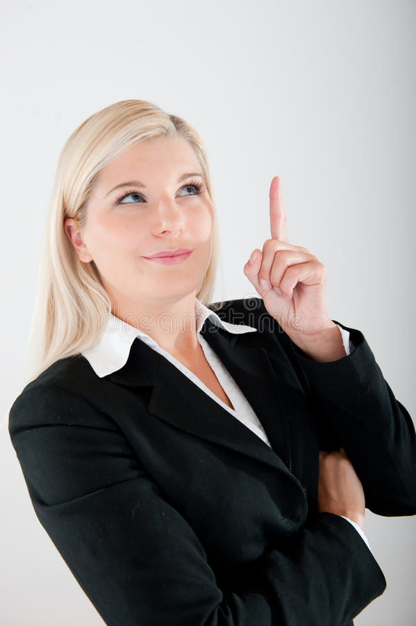 Young busines woman in a suit having an idea royalty free stock photography