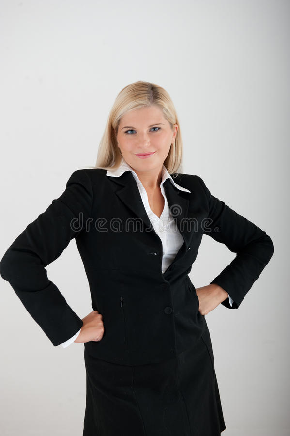 Young Busines Woman In A Suit Having An Idea Stock Photo