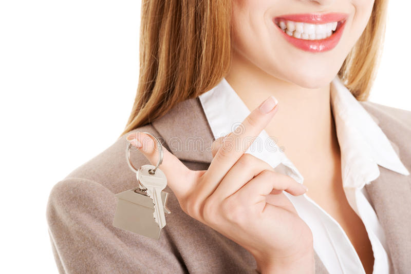 Young business caucasian woman is holding house keys. royalty free stock photo
