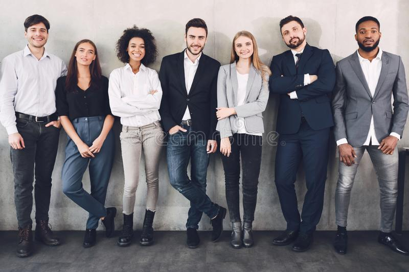 Young business colleagues smiling together to camera royalty free stock photo