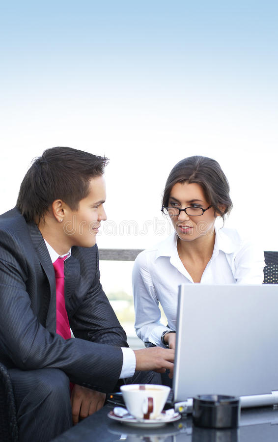 Download A Young Business Couple Is Working In A Cafe Stock Photo - Image of businesswoman, couple: 14679874
