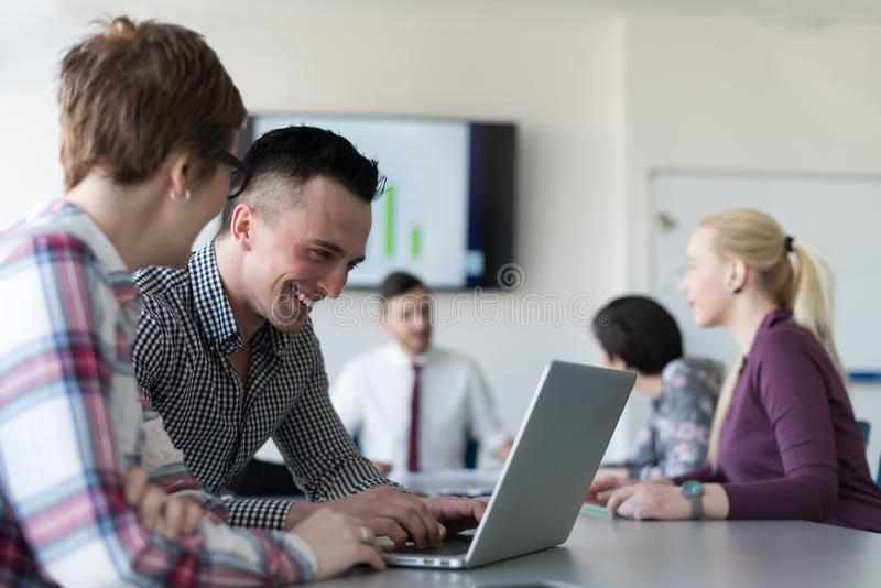 Young business couple working on laptop, businesspeople group on. Young startup business people, couple working on laptop computer, businesspeople group on royalty free stock photo