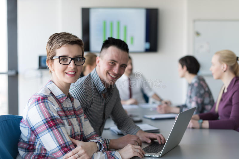 Young business couple working on laptop, businesspeople group on. Young startup business people, couple working on laptop computer, businesspeople group on royalty free stock images