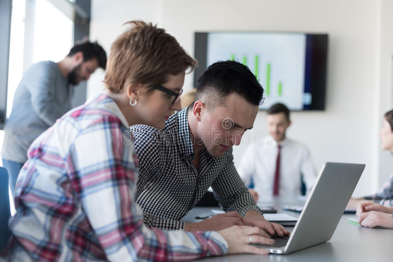 Young business couple working on laptop, businesspeople group on. Young startup business people, couple working on laptop computer, businesspeople group on royalty free stock image