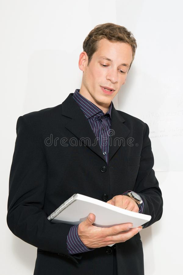 Download Young Business Dressed Male Holding Presentation Stock Photo - Image of handsome, line: 39862684