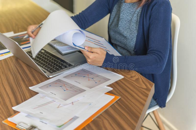 Young business employee reading sales report stock photography