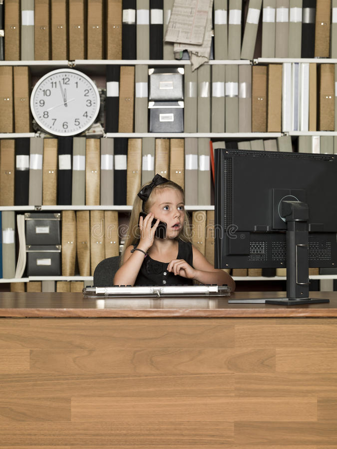 Young business girl on the phone stock images