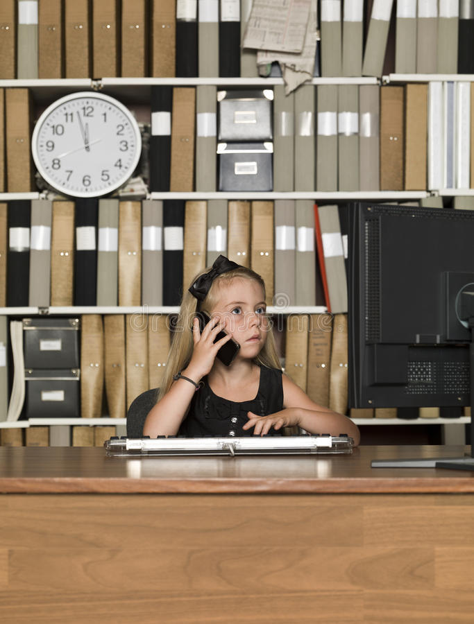 Young business girl on the phone royalty free stock images