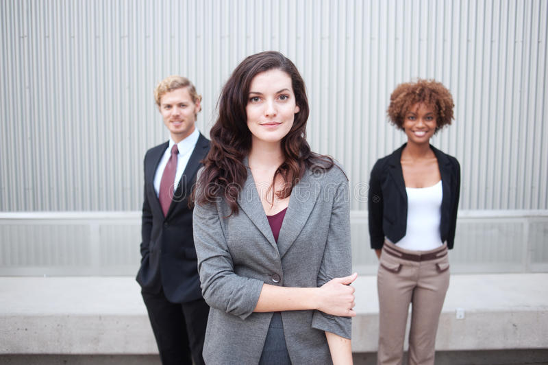 Download Young Business Group Standing Together At Office Stock Image - Image of casual, happy: 26785837